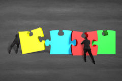 Team work for assembling puzzles Royalty Free Stock Photo