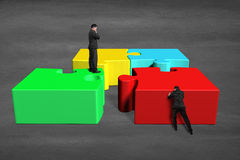 Team work for assembling puzzles Royalty Free Stock Photography