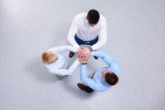 Team work concept. Business people joining hands.  stock image