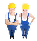 Team work concept - handsome man and beautiful woman in blue bui Stock Photos