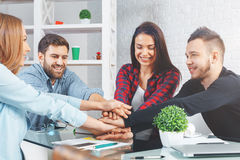 Team work concept. Happy male and female friends hi-fiving each other at workplace. Team work concept royalty free stock images