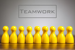 Team work concept with pawn figurines on table. Teamwork concept with pawn figurines on table, grey background Royalty Free Stock Photo