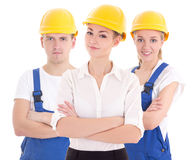 Team work concept - two young women and man in blue builder 's u Stock Photography