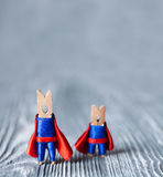 Team work conceptual image. Clothespins superheroes. copy space Stock Images