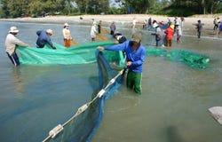 Team work of fisherman on beach Royalty Free Stock Photos