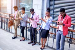Five africanamerican friends help their friends to pass exam online. Team work. five friends help their friends to pass exam online.side view photo stock photography