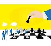 Team work. An intelligent chess team are playing board game with a big businessman Royalty Free Stock Images