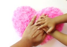 Team work man and kid touch heart stock image