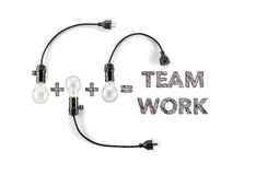 Team work phrase and light bulb, hand writing, together solidari Royalty Free Stock Photo