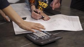 Team work on project development. Joint correction of work schedules stock footage
