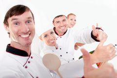 Team work-restaurant staff. Restaurant staff gesturing thumb up sign Royalty Free Stock Photos