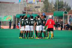 Team Work. SIALKOT, PAKISTAN - DECEMBER 2014: All Pakistan Annual Field Hockey Tournament Between PIA and PAF Teams at Sialkot International Hockey Stadium on royalty free stock images