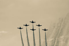 Team work in sky. Team of airplanes flying together on air show, concept of teamwork Stock Photo