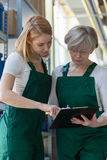Team work in storehouse. Two women and team work in big storehouse Royalty Free Stock Photos