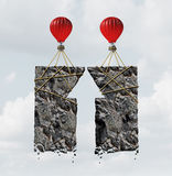 Team Work Success. Business concept and combined effort symbol as a group of air balloons tied to heavy rocks shaped as an upward arrow as a financial Royalty Free Stock Photos