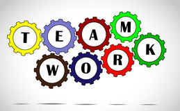 Team work text inside colorful gears placed next to each other with a bright white background Royalty Free Stock Image