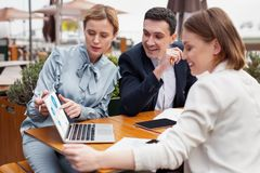 Three company leaders enjoying their team work. Team work. Three prosperous company leaders feeling wonderful while enjoying their productive team work Stock Photos