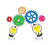Team work. Two business bulb-man hold gears and work together Stock Images