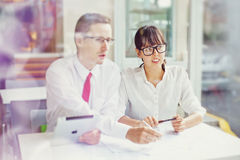 Team work. Two colleagues working on project together Royalty Free Stock Image