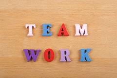 TEAM WORK word on wooden background composed from colorful abc alphabet block wooden letters, copy space for ad text stock photo