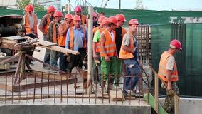 Team of workers at construction site stock video footage
