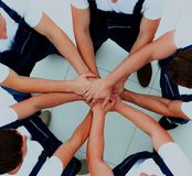 Team of workers joining hands in circle. Royalty Free Stock Photos