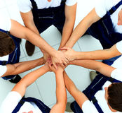 Team of workers joining Stock Image