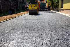 Team of Workers making and constructing asphalt road constructio Stock Photos