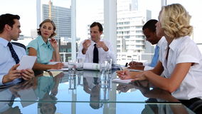 Team of workers during a meeting stock footage