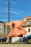 Team of workers restoring memorial. Kursk. Russia stock photo
