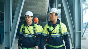 Team of workers walking on industrial plant.  stock footage