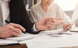 Team working on business project with financial reports royalty free stock photos