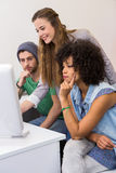 Team working at computer desk Royalty Free Stock Images