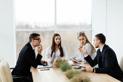 Team working in conference room in modern office. Royalty Free Stock Photos
