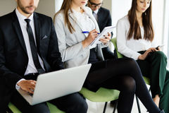 Team working at conference sitting on chair and make notice. Stock Image