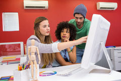 Team working at desk with colour samples Royalty Free Stock Photos