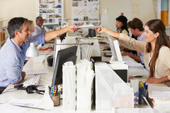 Team Working At Desks In Busy Office Stock Images