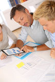 Team working on financial reports Royalty Free Stock Photo