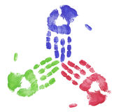 Team working together. Finger painted hands showing concept of team working together Royalty Free Stock Images