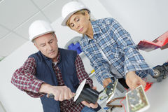 Team workmen working together Royalty Free Stock Photography