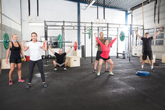Team workout with weights at fitness gym center Royalty Free Stock Photo
