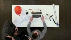 Team of young architects preparing to start new project stock video