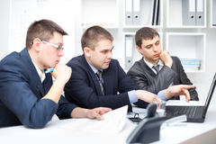 Team of young business men working Royalty Free Stock Photos