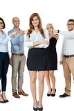 Team of young business people mobbing bullying collegue Royalty Free Stock Photography