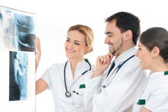 A team of young Caucasian doctors holding x-rays Royalty Free Stock Image