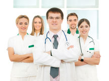 A team of young Caucasian doctors in white clothes Royalty Free Stock Images
