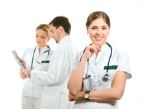A team of young Caucasian doctors in white clothes Royalty Free Stock Photos