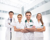 A team of young Caucasian doctors in white clothes Royalty Free Stock Image