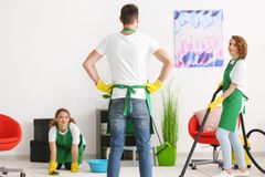 Team of young cleaning service professionals. At work indoors stock photos