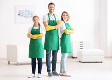 Team of young cleaning service professionals at work. In office royalty free stock images